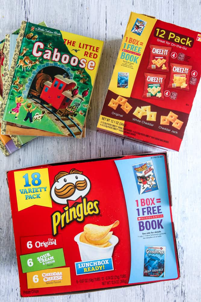 pringles box and books overhead view grey background
