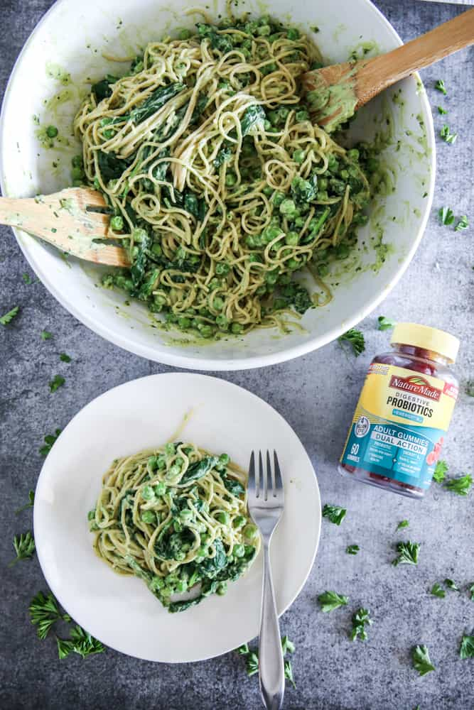 avocado spaghetti in bowl and serving bowl with probiotics