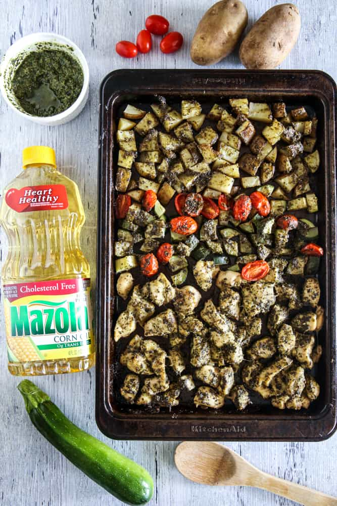 pesto chicken and vegetables with mazola corn oil overhead view