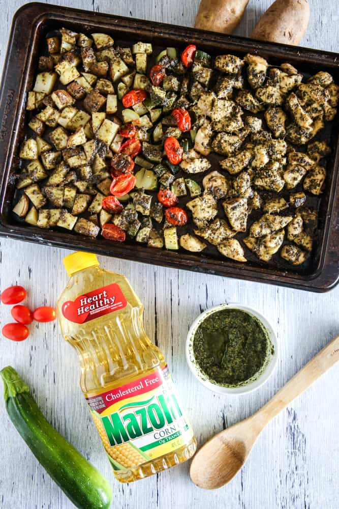 Sheet Pan Pesto Chicken and Vegetables overhead view grey background