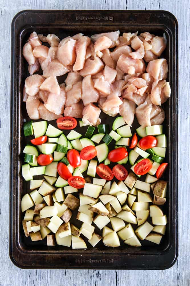chicken and potatoes in pan without seasoning