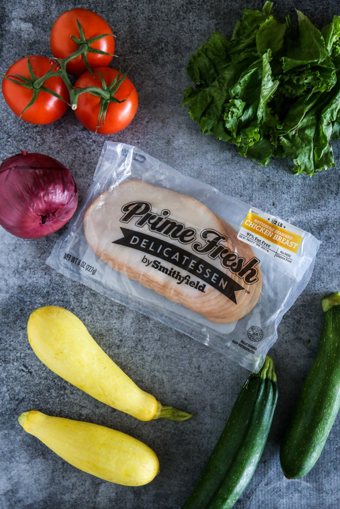 package of chicken breast with vegetables
