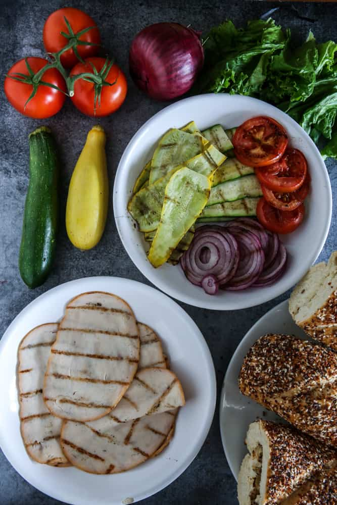 grilled sliced vegetables and grilled sandwich eat on plates