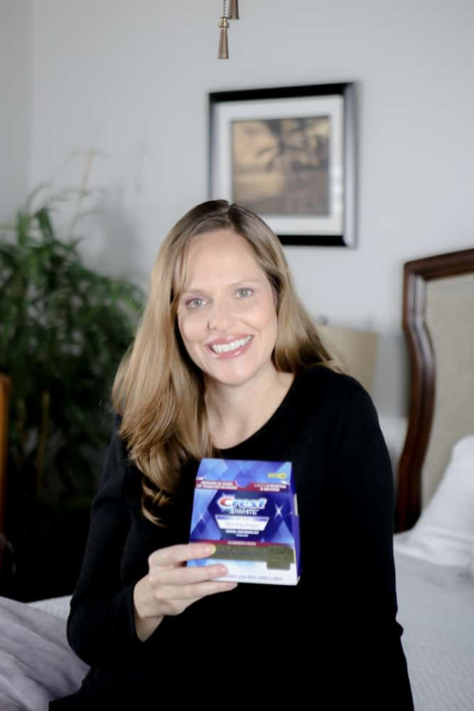 woman holding crest white strips box