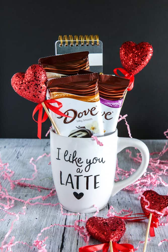 coffe mug with dove chocolate, heart toothpicks, and notepad