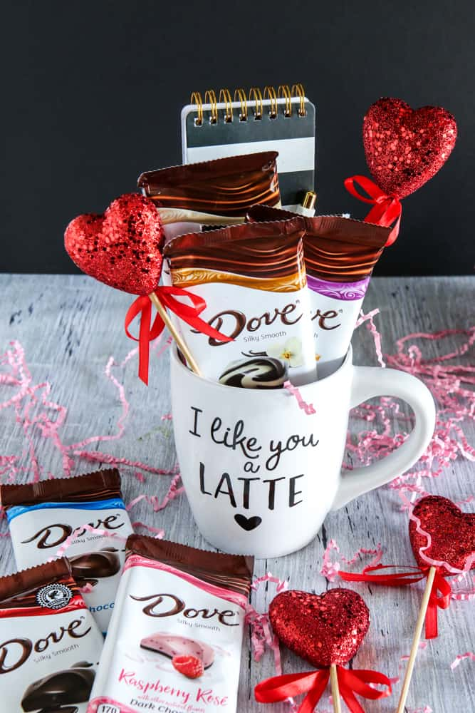 dove chocolates in coffee mug grey background