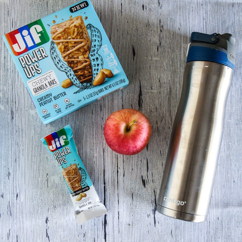 single jif powerup box and bar with fruit and water bottle