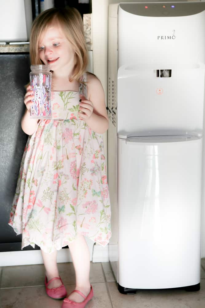 young girl about to drink water