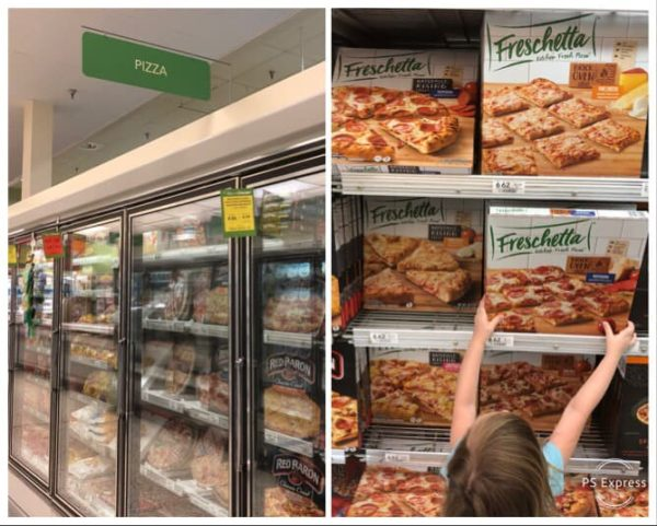 grabbing pizza out of frozen foods aisle