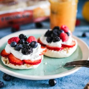 Lemon Curd and Cream Topped English Muffins with Fresh Berries close up photo