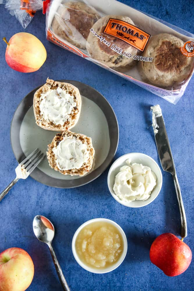 sour cream spread on cut english muffin