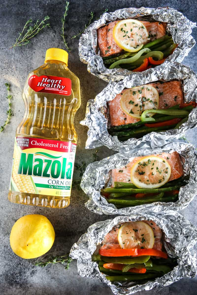 mazola corn oil and four salmon cuts side by side grey background
