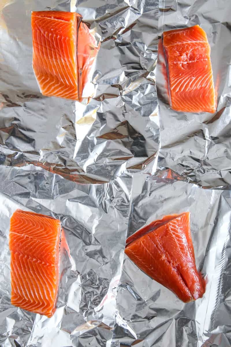 four cuts of raw salmon on tinfoil