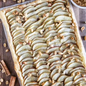 overhead view of a peanut butter apple tart in a pan