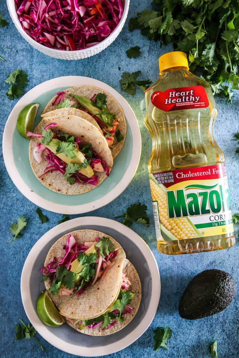salmon tacos with mazola corn oil avocados and red cabbage