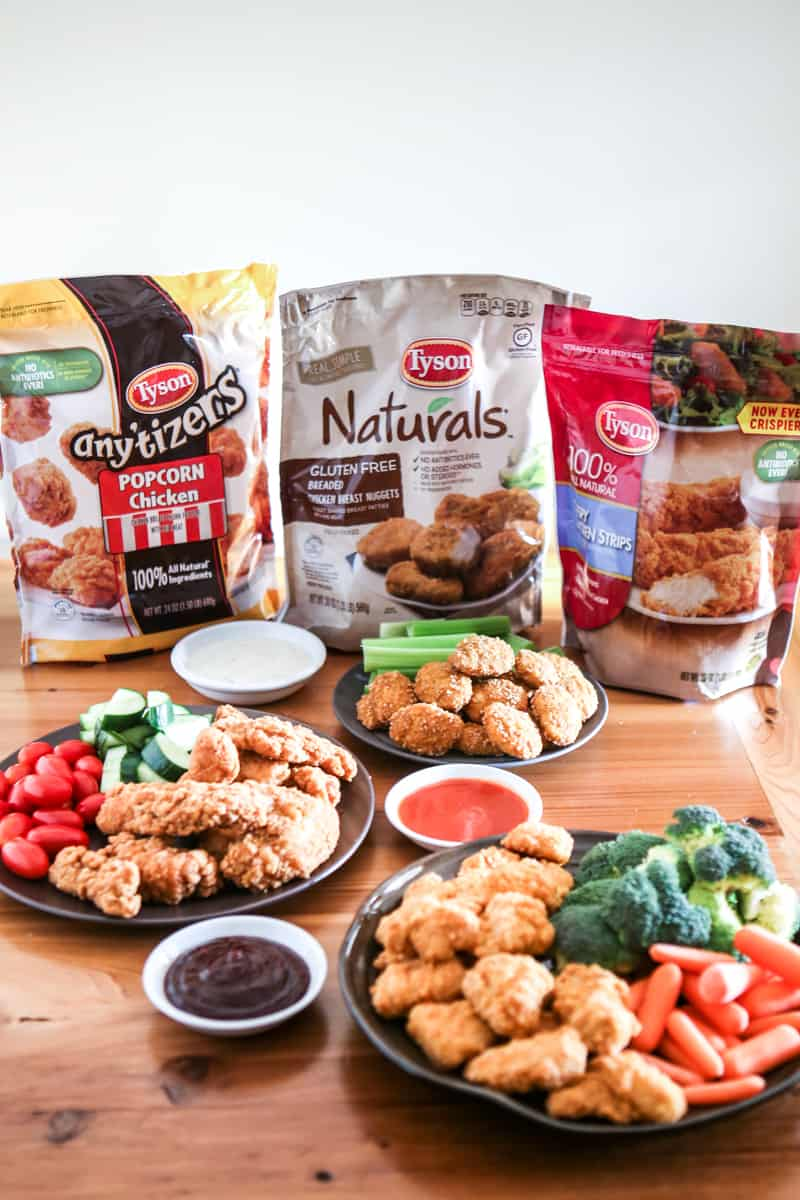 three bags of tyson anytizers, naturals, and chicken strips