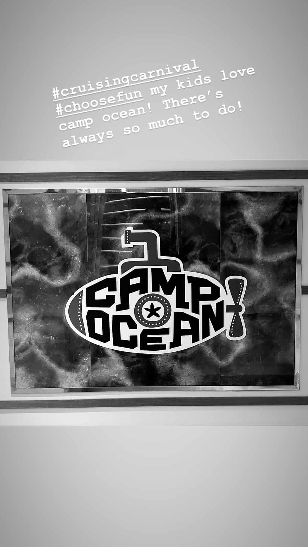 black and white photo of camp ocean sign
