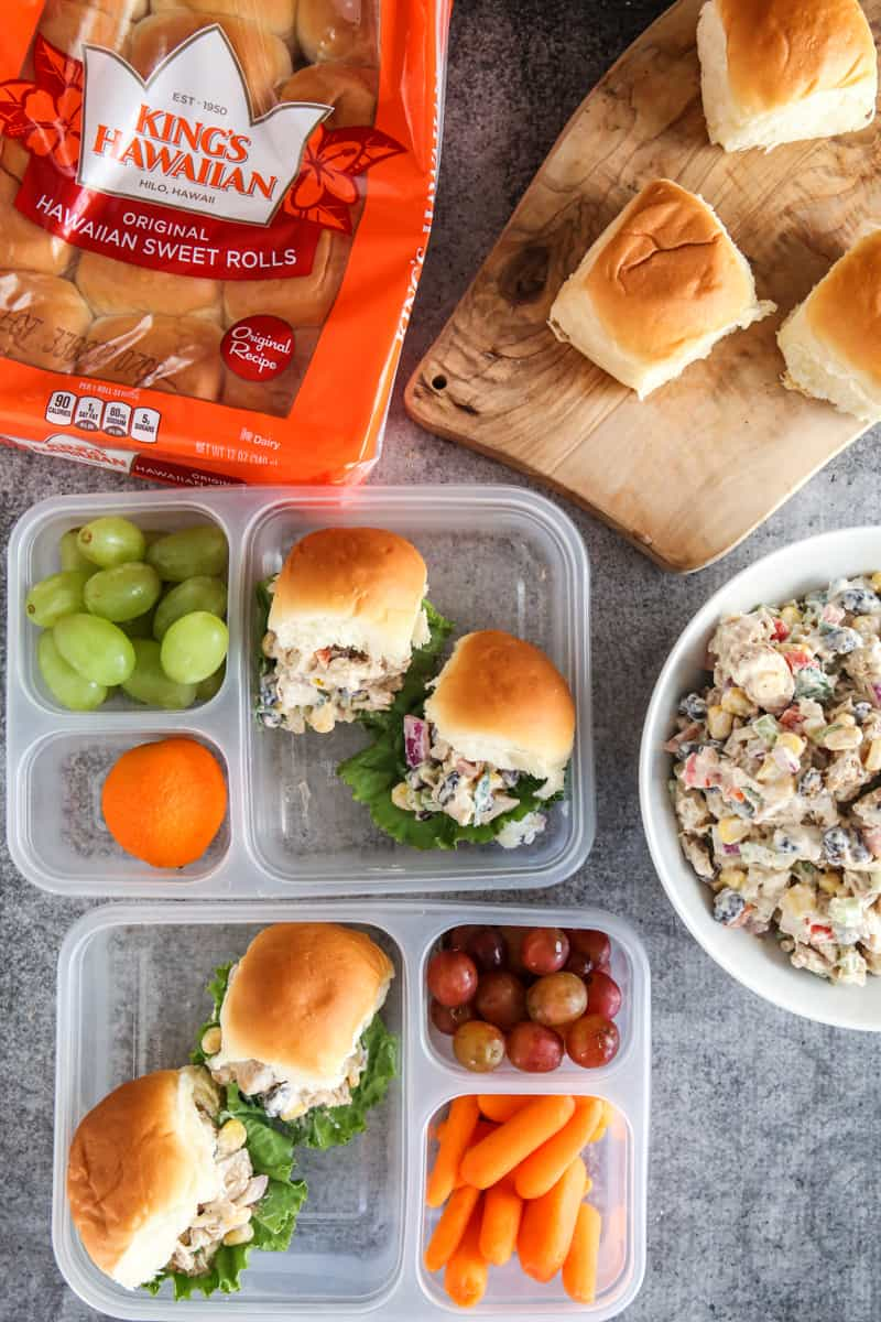 sliders in lunch boxes with bowl of tex mex filling on grey background