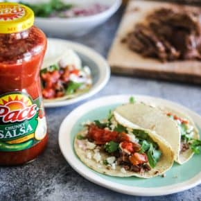 pace salsa jars beside tacos on plate