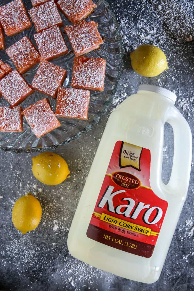 cut pink lemonade bars with jug of karo corn syrup