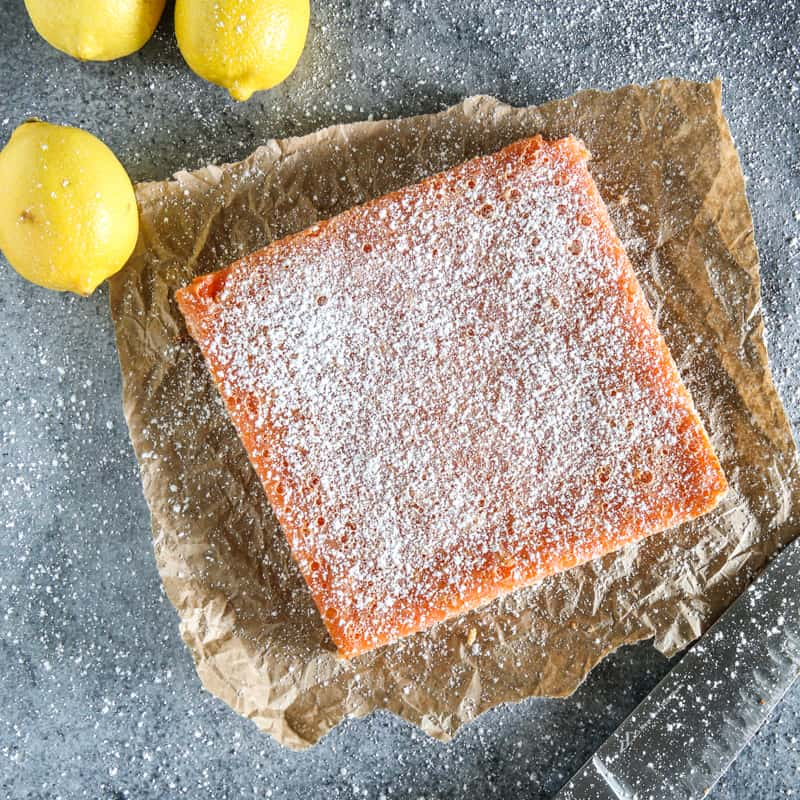 uncut pink lemonade bar sprinkled with powdered sugar