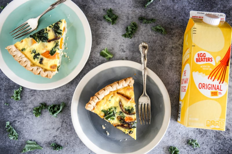 two slices of butternut squash quiche with carton of egg beaters and two forks