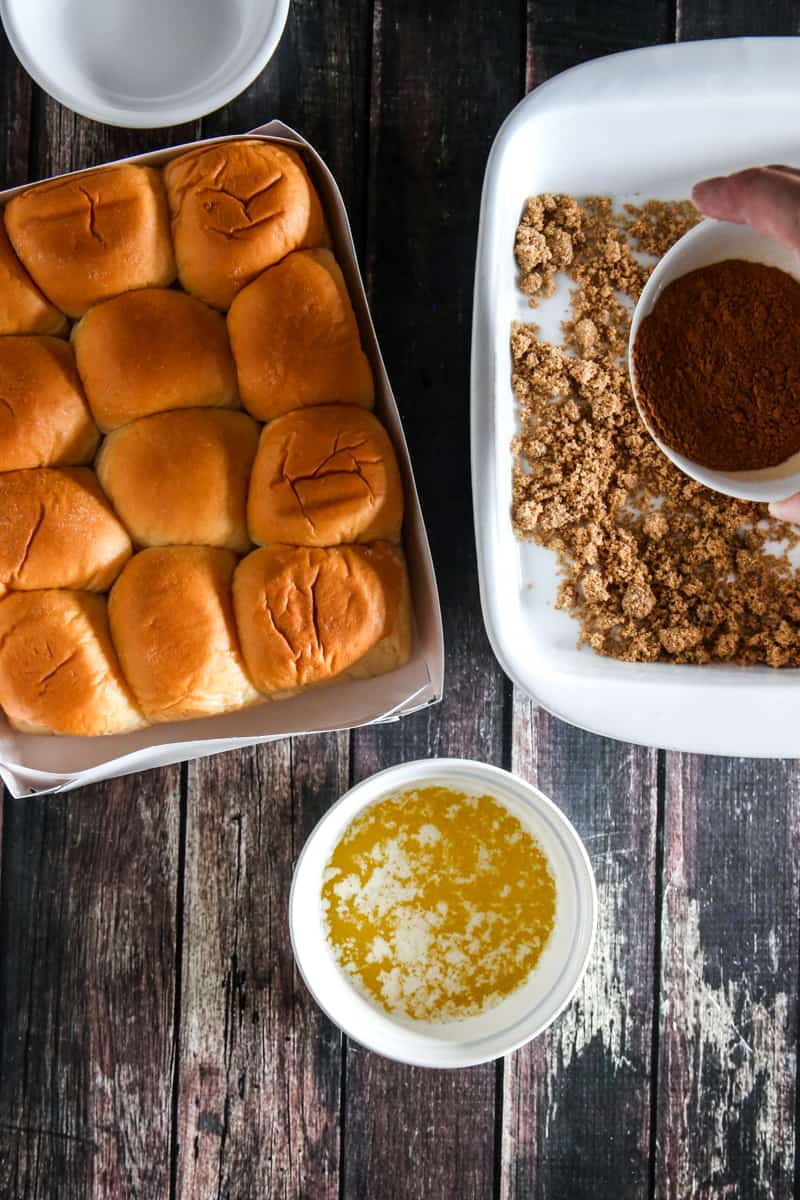 king's hawaiian rolls with pan filled with cinnamon crumbs
