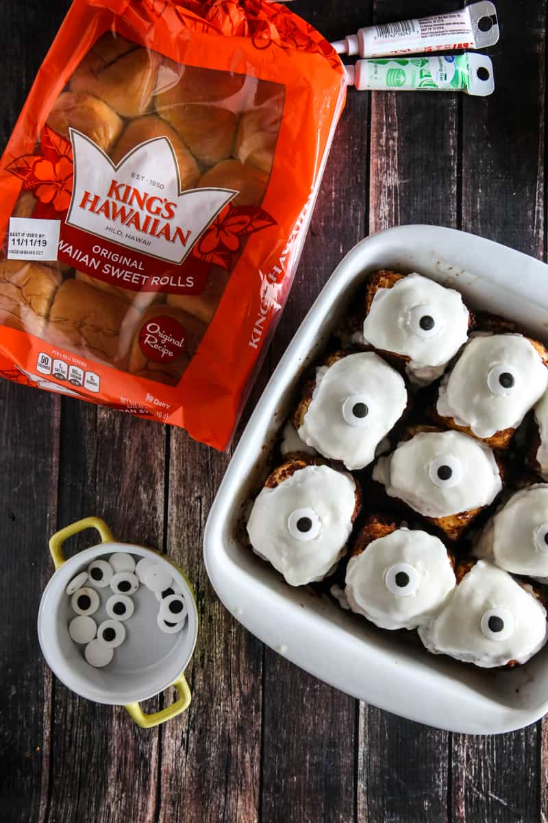 nine king's hawaiian rolls with frosting and eyes