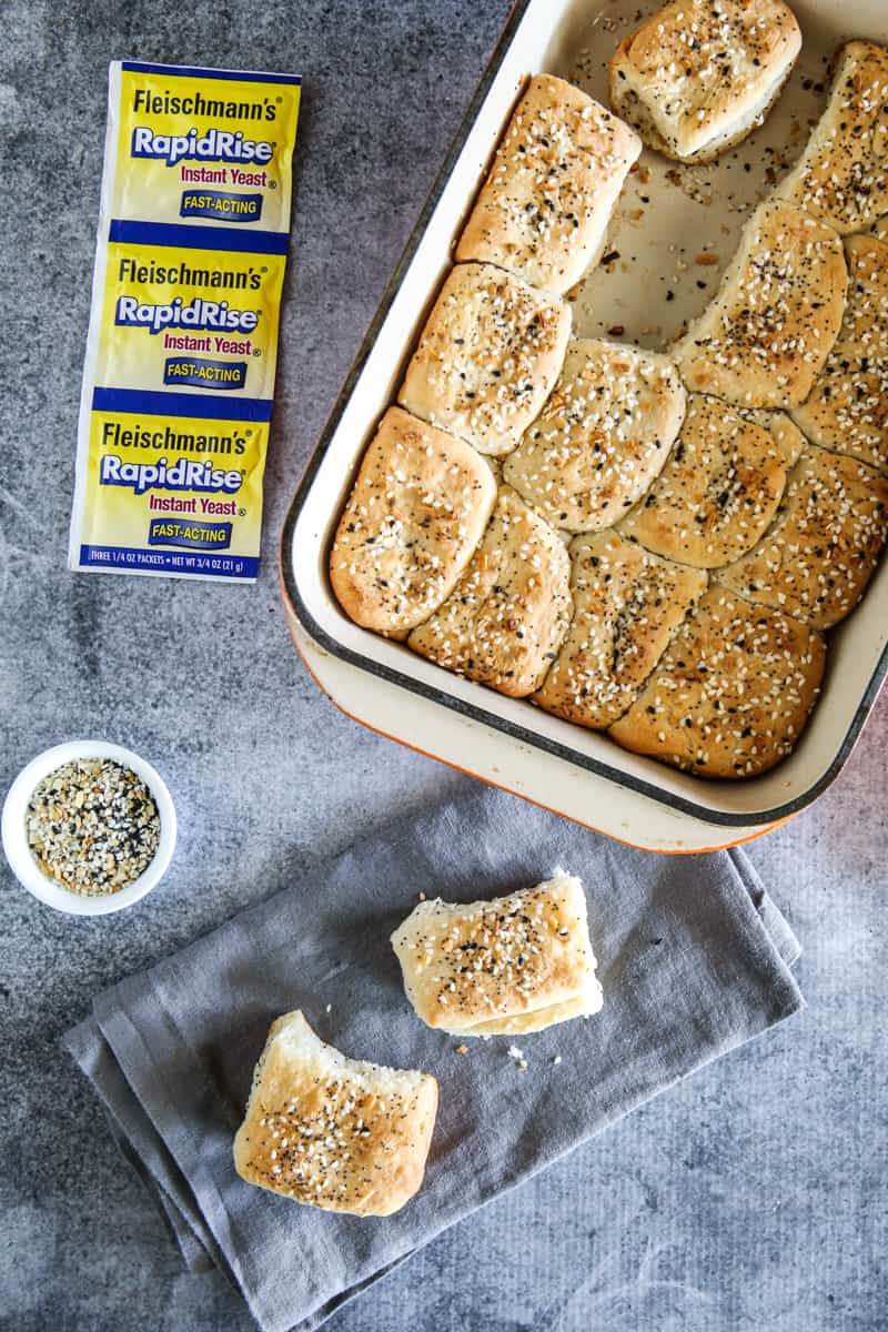 everything parker house rolls with rapid rise yeast packets and bowl of seasoning