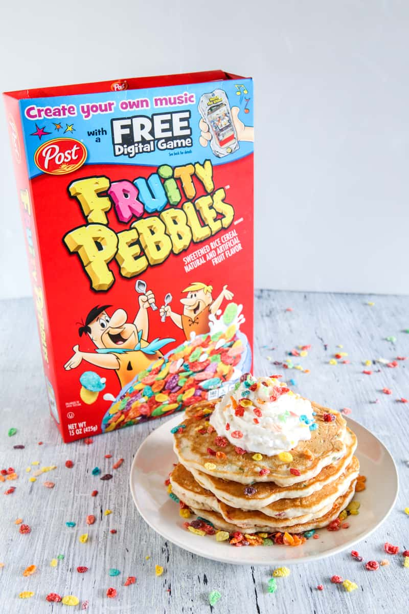 fruity pebbles cereal and pancakes on white background