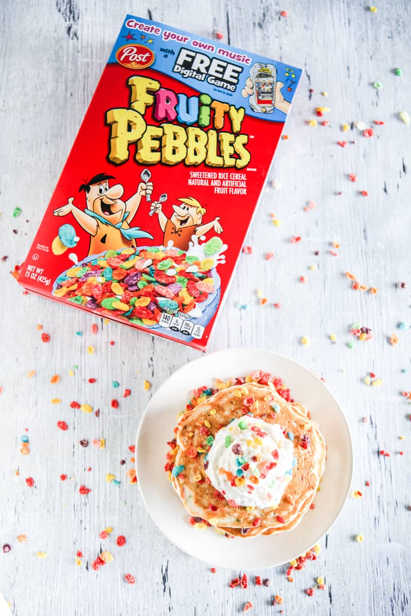 fruity pebbles cereal and pancakes with whipped cream