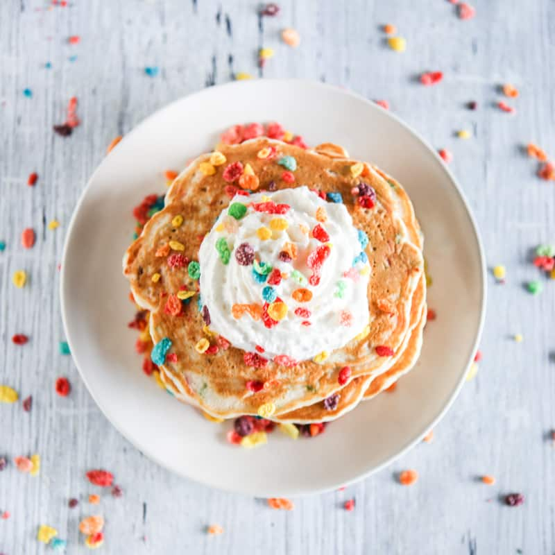 fruity pebble pancakes with whipped cream