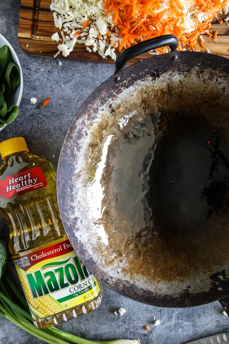 old wok with mazola corn oil