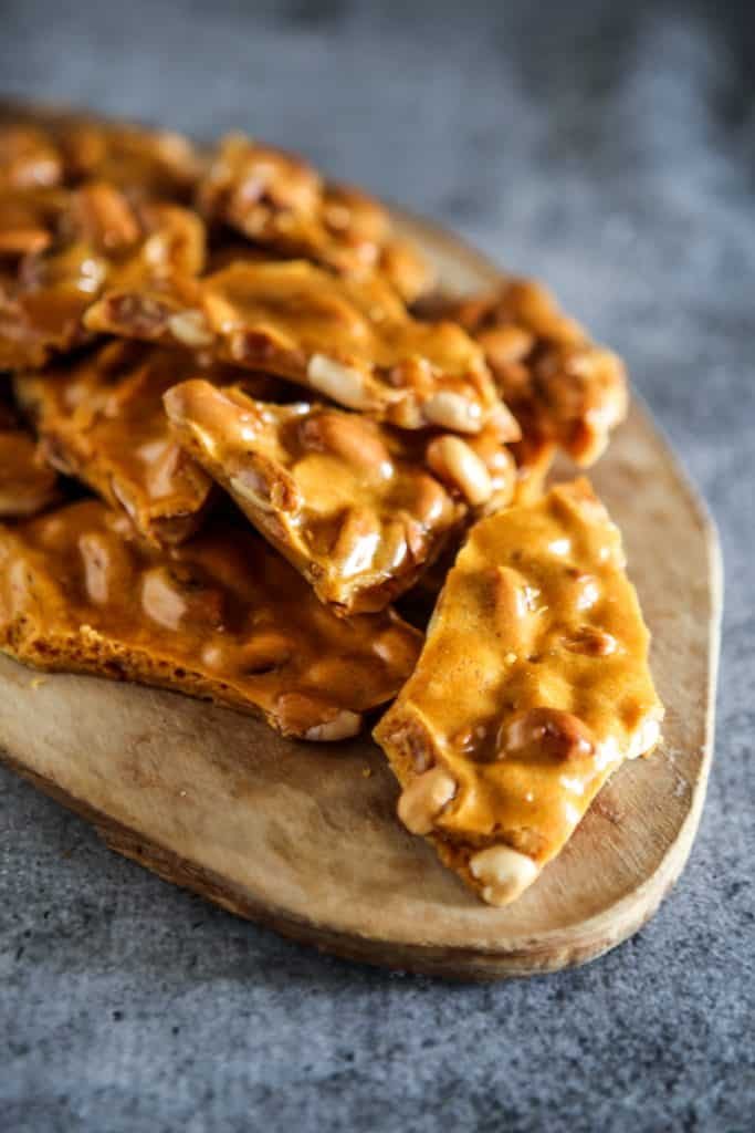 peanut brittle from overhead on raw wood