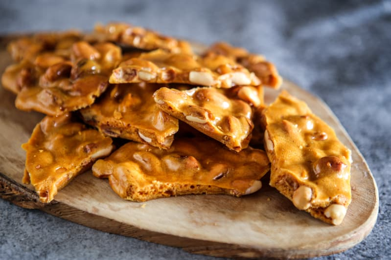 peanut brittle on wood board