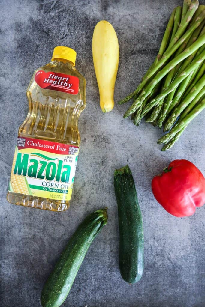 Cooked vegetables and chicken with Mazola corn oil